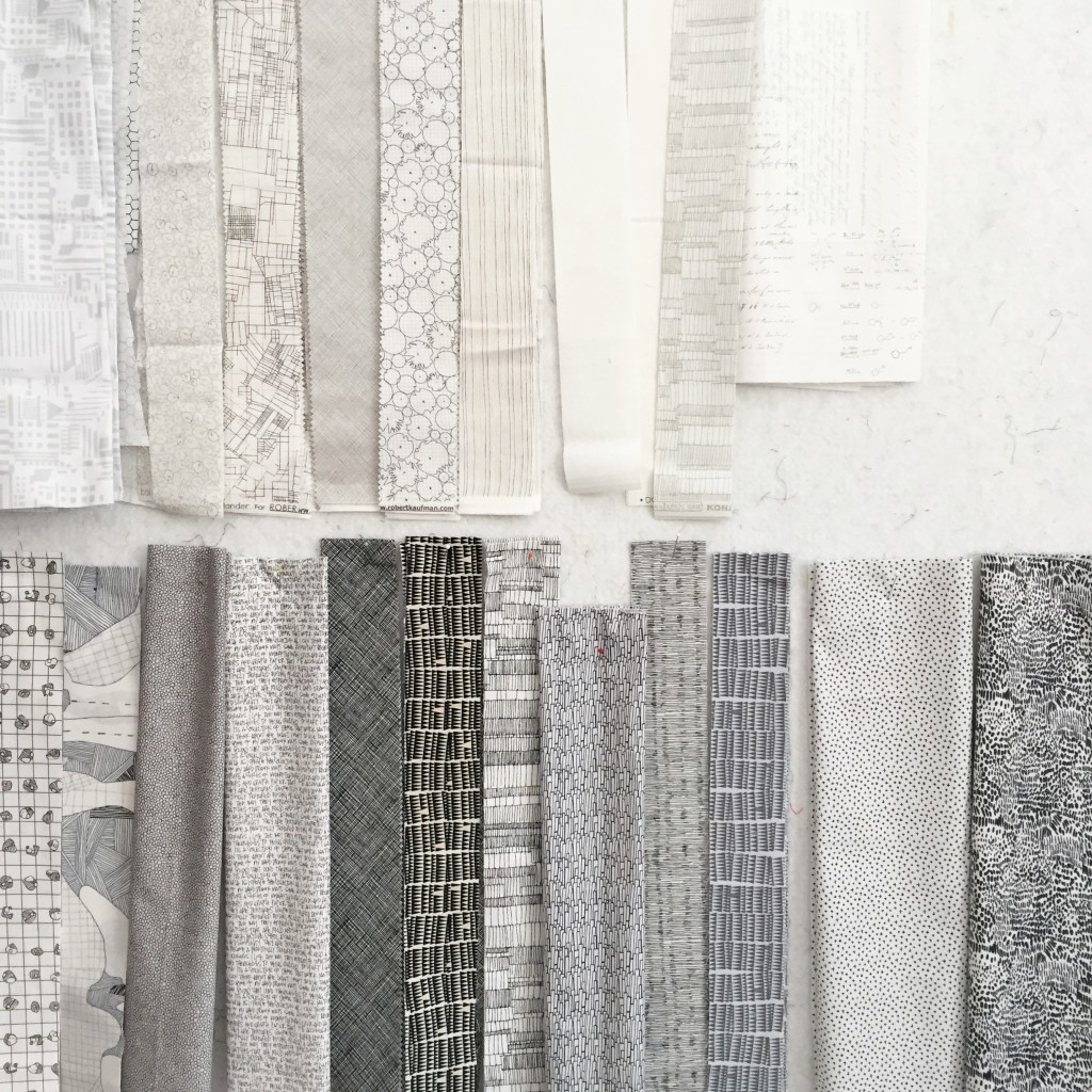 strips of white and gray fabrics